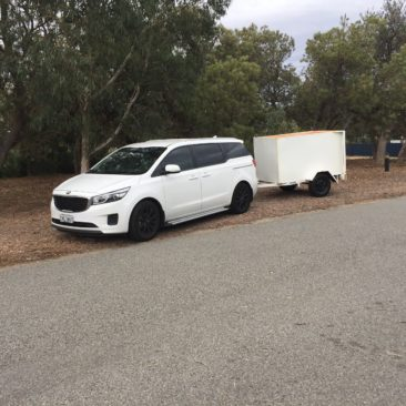 Our 7 Passenger Seater Kia Carnival with Optional Enclosed Luggage Trailer